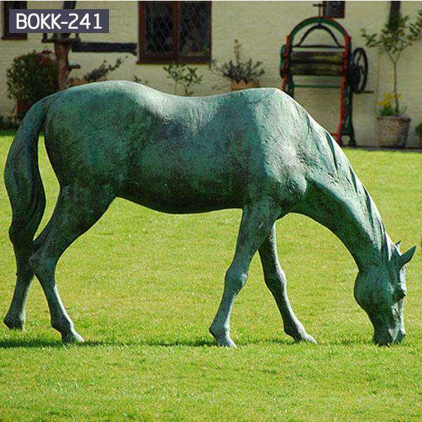 Contemporary green standing grazing horse sculpture UK